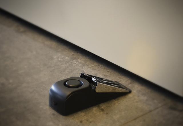 Mobile door alarm placed behind a door