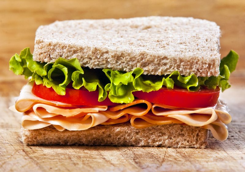 Whole wheat turkey sandwich with lettuce and tomato